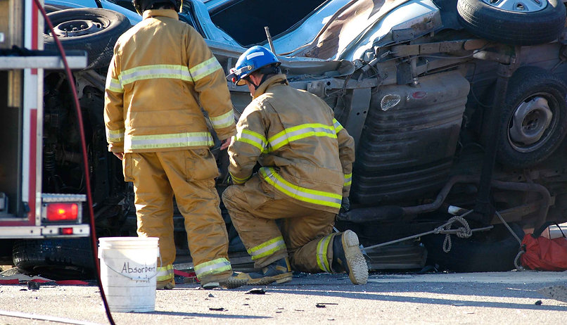 Two firefighters working a car accident