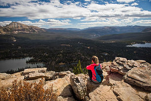 woman-hiker-in-red-jacket-overlooking-mo