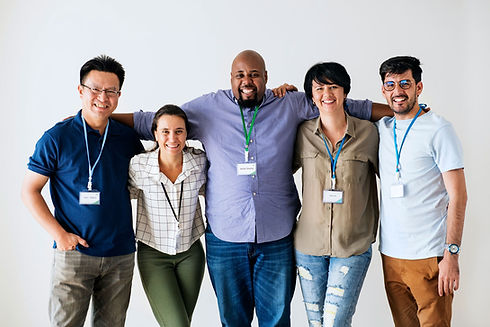 group-of-diverse-employees-smiling-in-gr