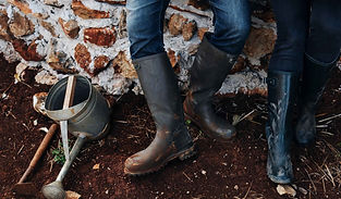 close-up-of-rubber-boots-of-farmer-and-w