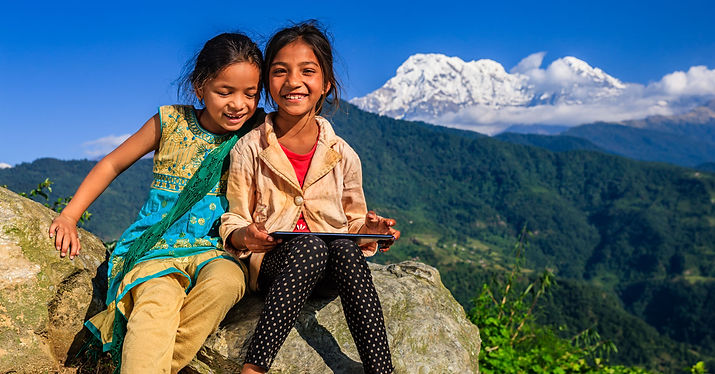 two-young-indian-girls-sitting-on-a-rock
