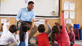 Teacher-with-Students-raising-their-hand