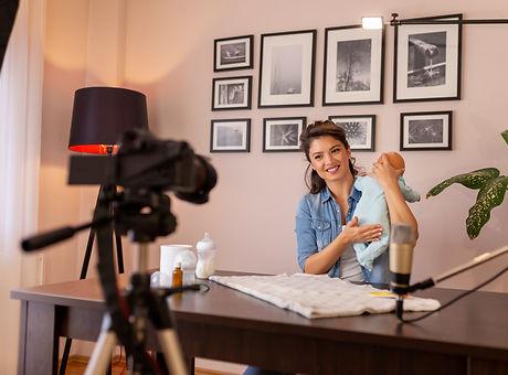 Influencer recording video about newborn