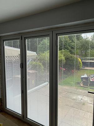 Origin Bi-fold door with blinds