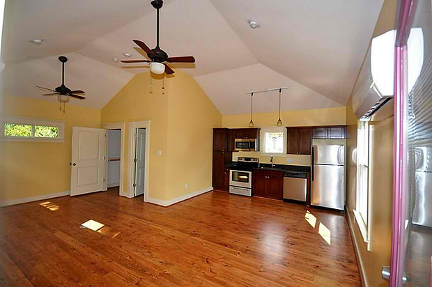 Open floorplan with a full kitchen by Harvard Heights