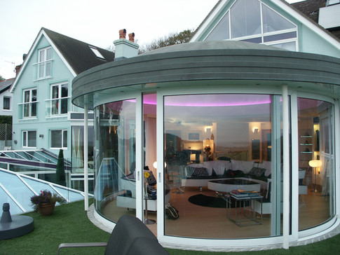 Curved sliding glass doors make a dramatic statement on any property