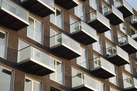 Low-maintenance glass balconies look good and let in light
