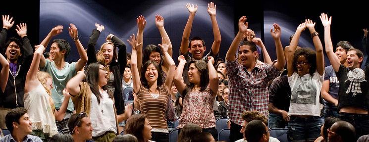students-cheering-in-auditorium.jpg