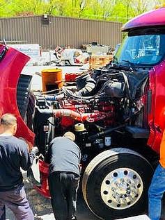 Mechanics working on a client's truck