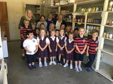 St. Paschal Kindergarten Students Pitch In to Fill the Shelves