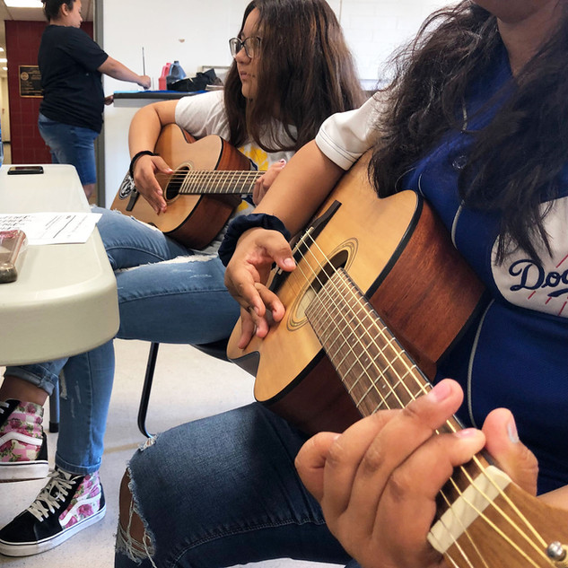 Youth students learning guitar