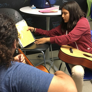 Youth student learning guitar