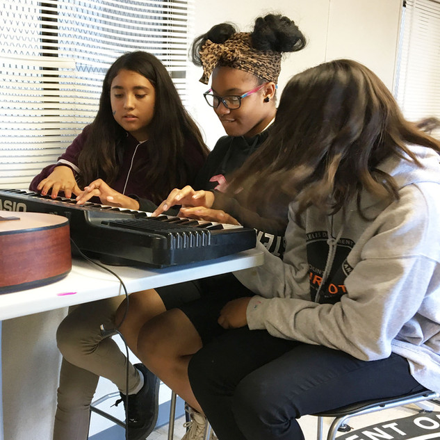 Youth student learning keyboard