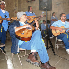 Students learning at Chino state prison
