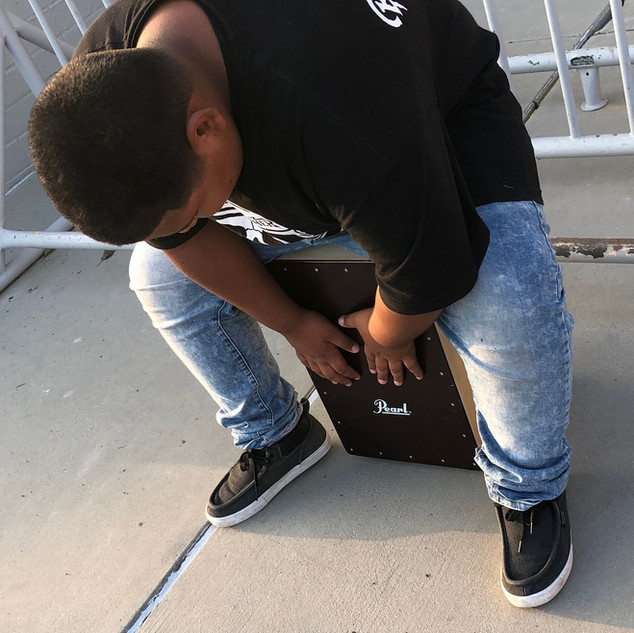 Youth student learning cajon