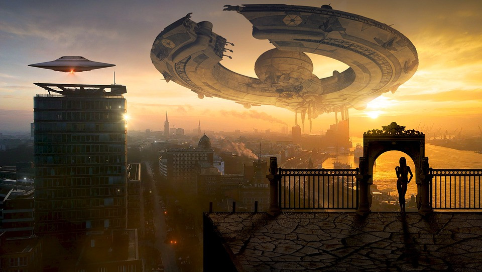 Photo of a round spaceship over a futuristic-looking city.