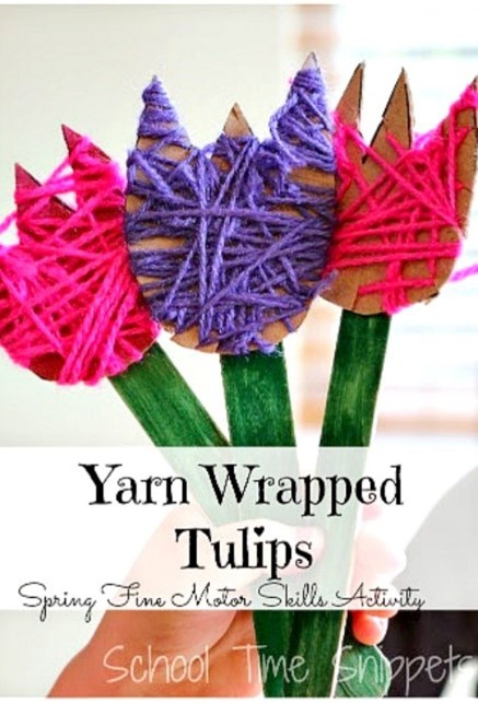 Tulips cut from cardboard, wrapped in purple and pink yarn.