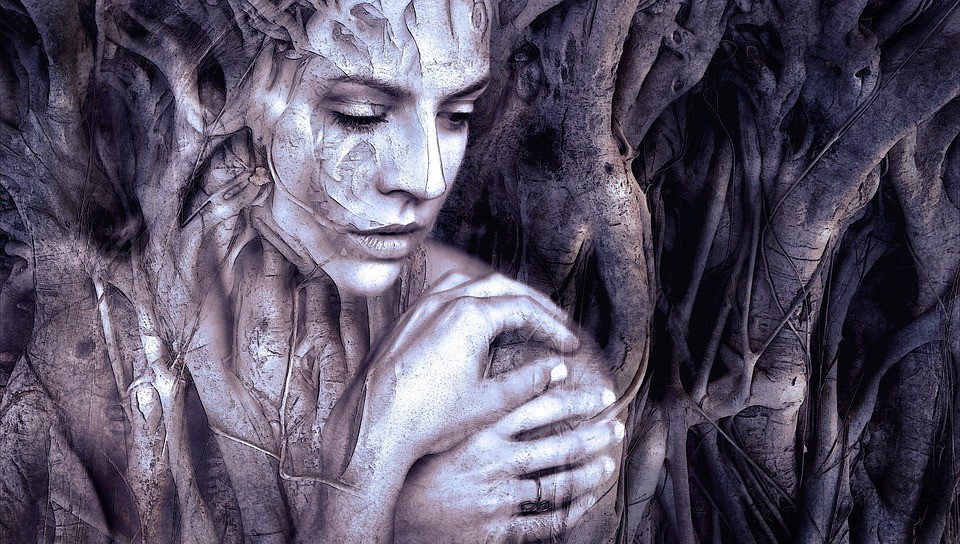 An image of a woman in the trees.