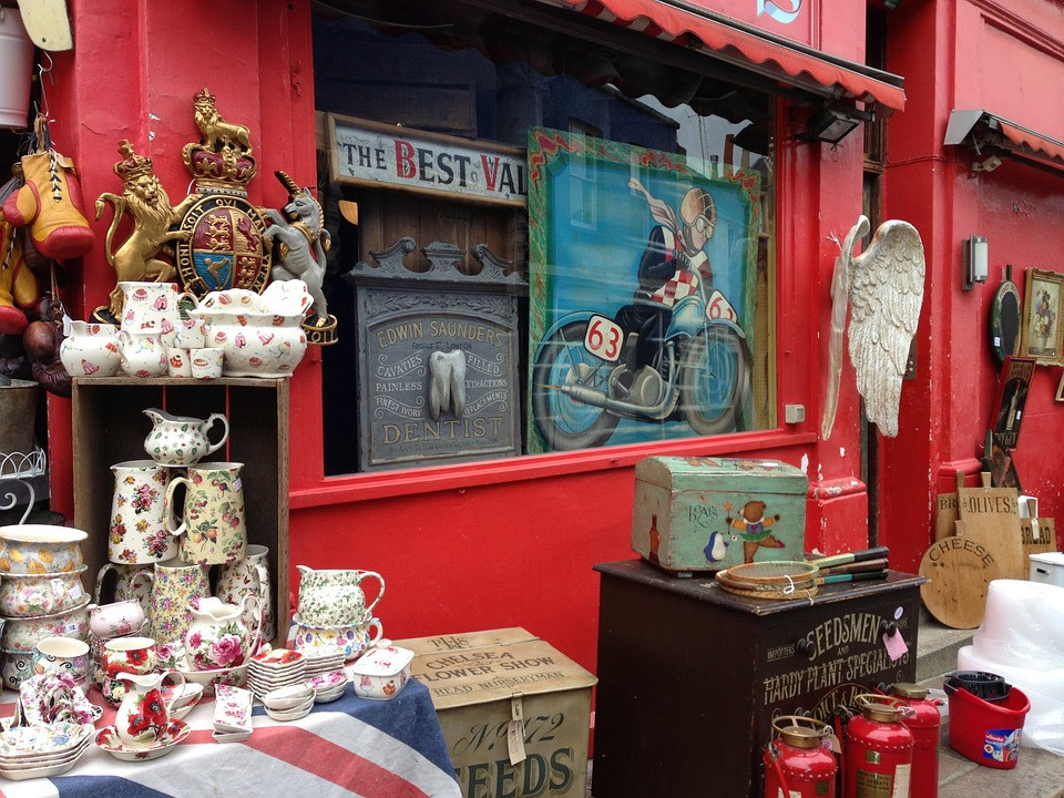 Front view of a vintage/antique store with antique dishes in the foreground