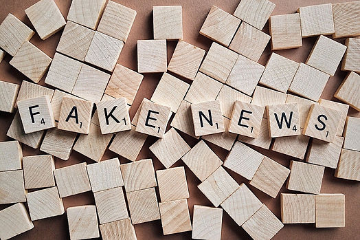 "Wooden scrabble tiles spelling out ""Fake News"""