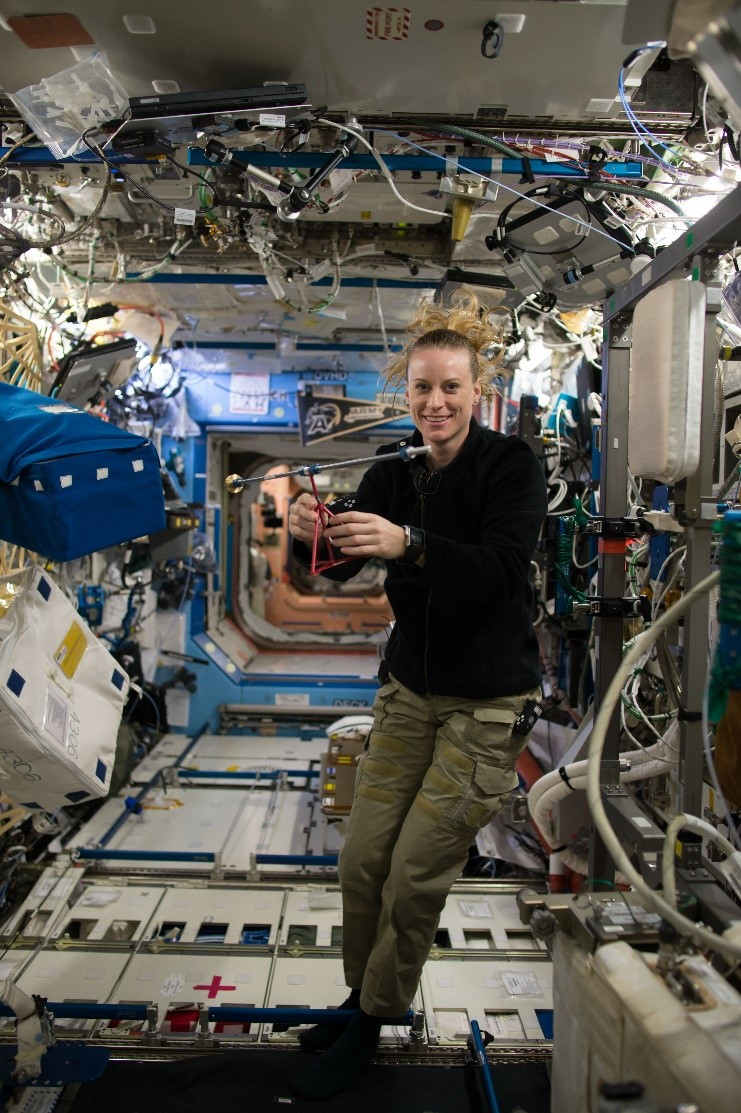Female astronaut hanging out in a shuttle