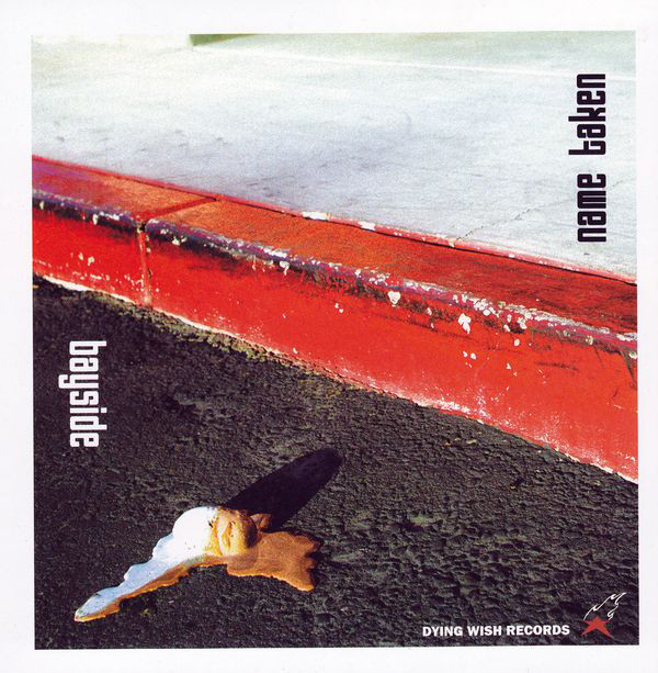 "Cover of Album - red curbside with ""bayside"" on asphalt and ""name taken"" on concrete sidewalk. Melting ice cream on the asphalt"