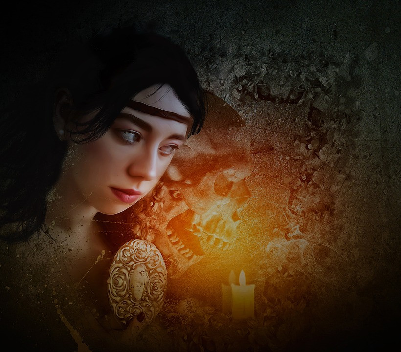 Girl with a skull shadow lit by a yellow flame candle