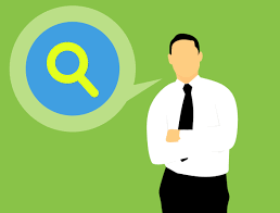 Image of a man with a speech bubble. Speech bubble has a magnifying glass symbol.