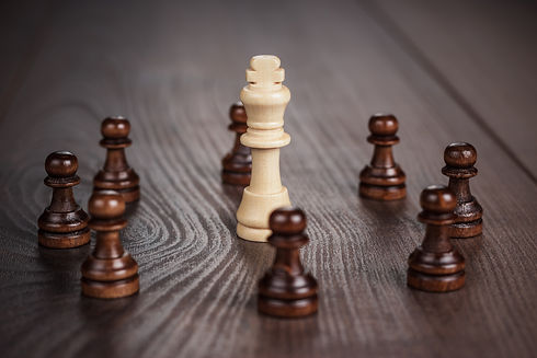 chess-win-concept-over-wooden-background