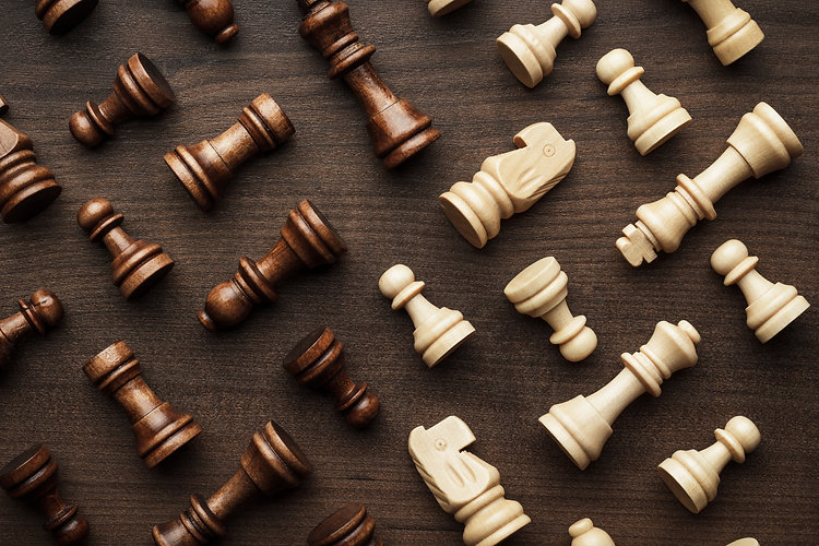 chess-figures-on-brown-wooden-table-back