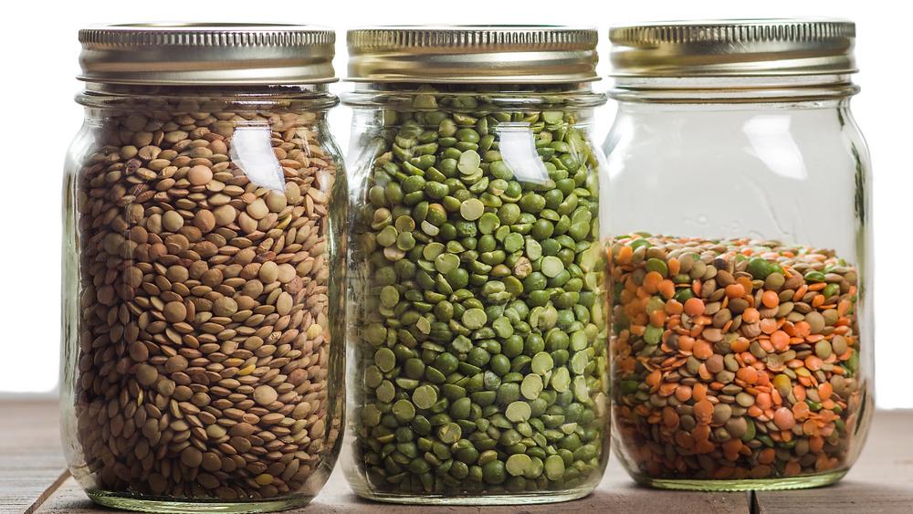 Dried lentils in jars