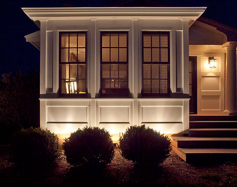 a home accented with landscape lightng to create a welcoming effect