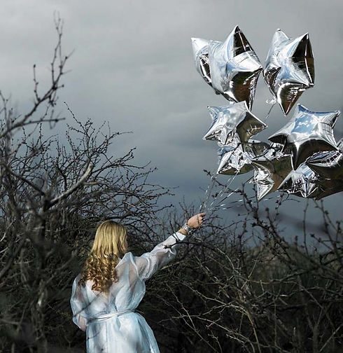 Woman with Silver Star Balloons