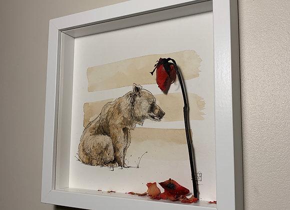 Sitting  bear contemplates rose