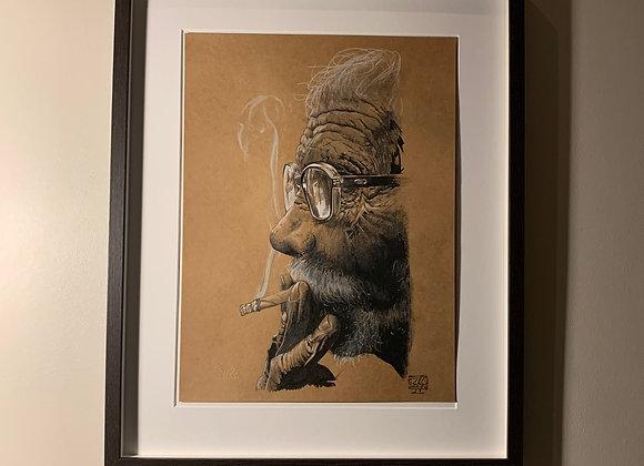 Man with glasses smoking
