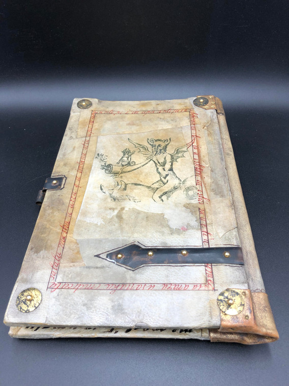 back cover in antique vellum decorated with cooper details