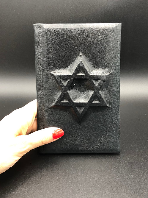 Star black leather notebook
