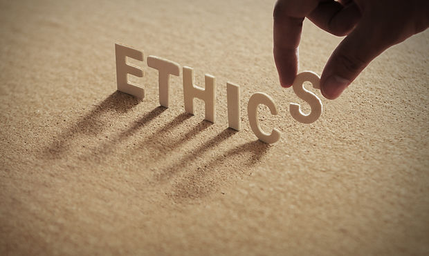 ETHICS wood word on compressed board wit