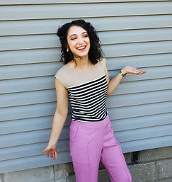 Rachel Dorsey, SLP, smiling in a striped shirt and pink pants