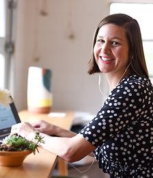 Meg Proctor at computer, smiling