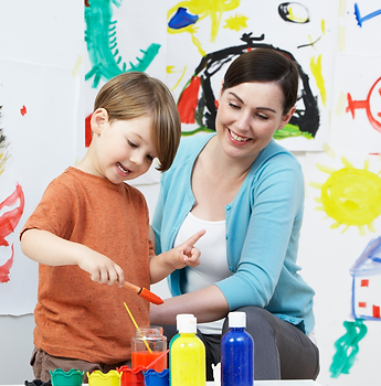 therapist working with kids with autism