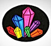 The Charmed Crystal L.L.C. Logo