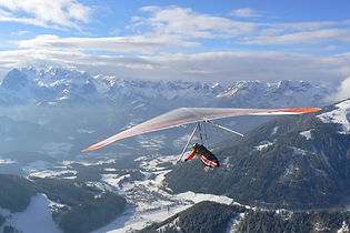 Bruno flying his hang glider in the Alps