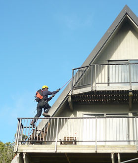 Using climbing rope systems to access a steep roof