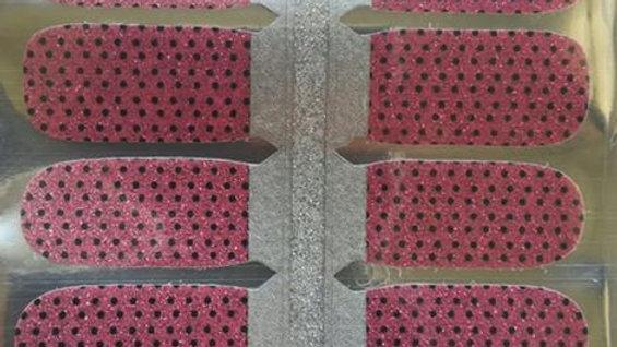 Black mini polkas on pink