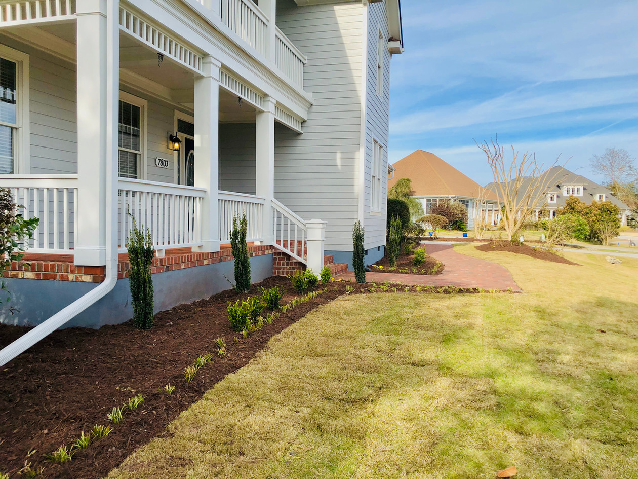 New sod and bedding plants brightened and finished the look of this house.