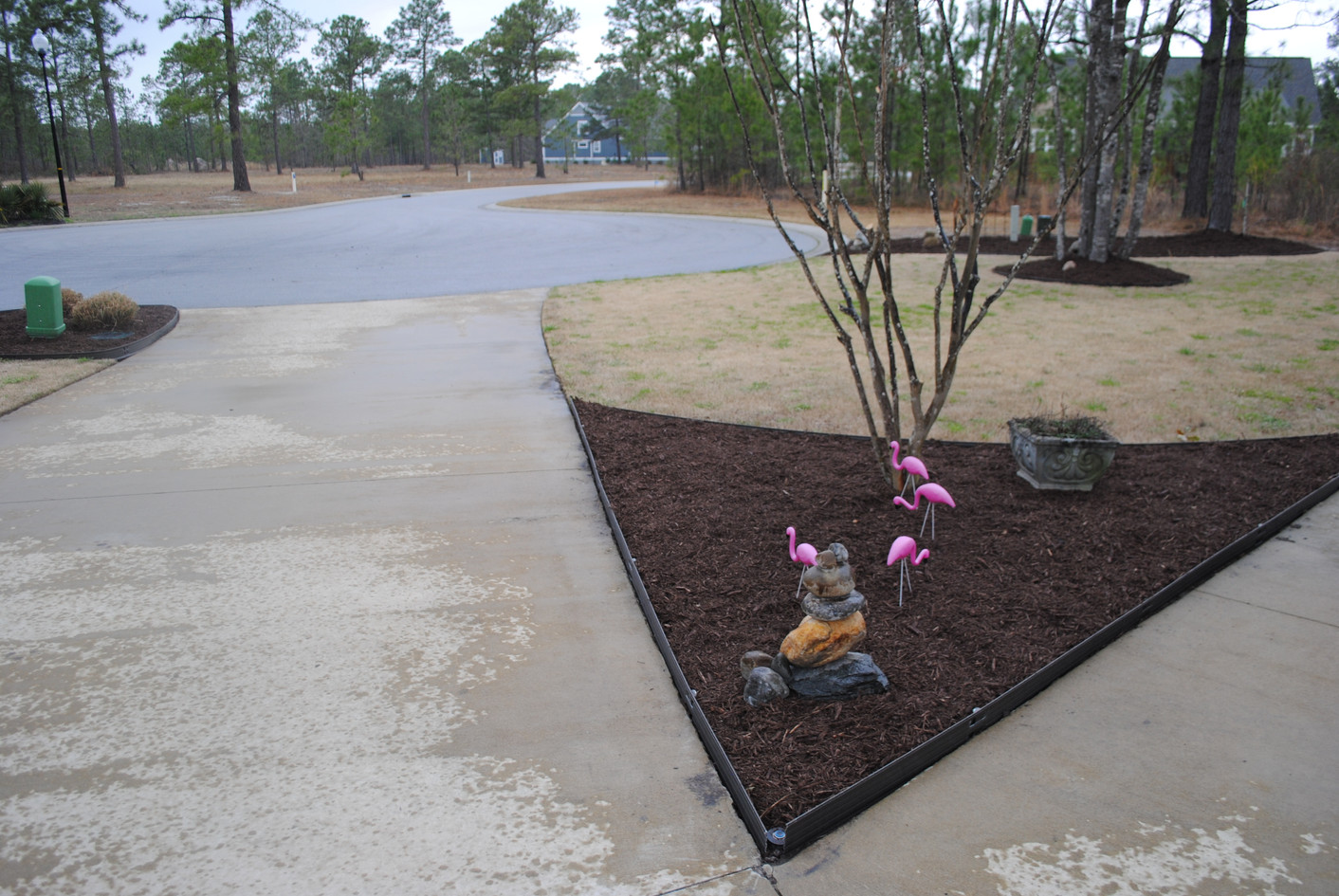 New edging at the driveway keeps mulch from staining the pavement.