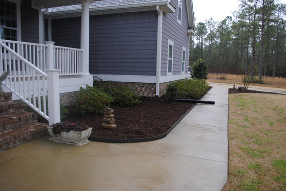 Mulch just installed.  The drain pipe was buried just days after this photo was taken.