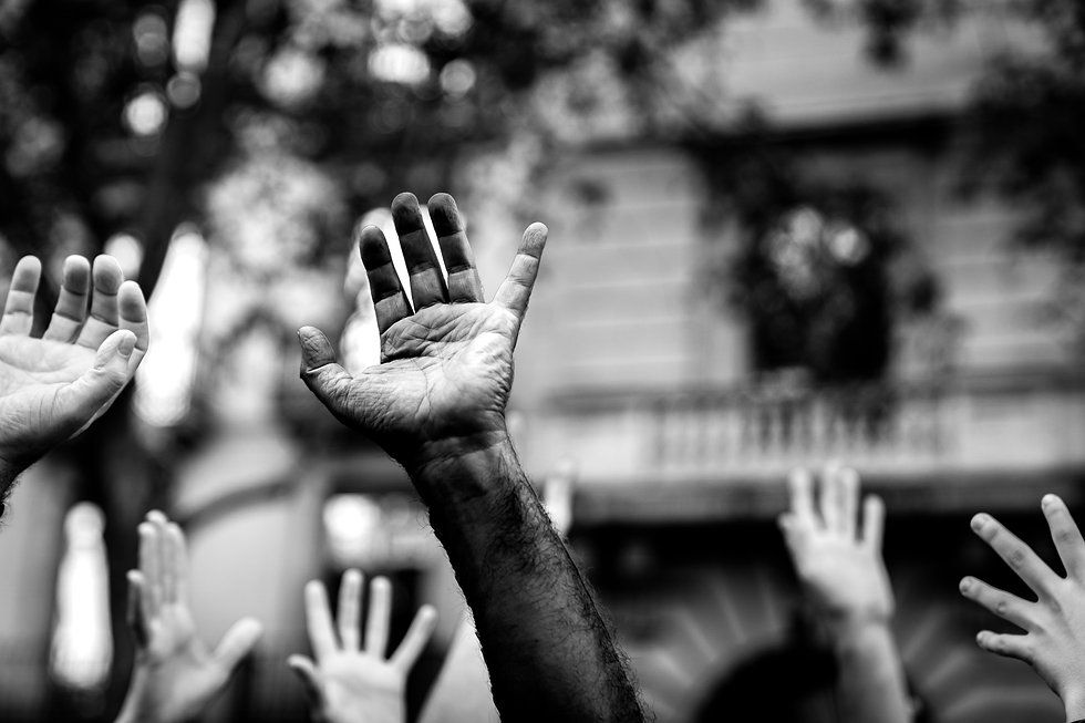 Multicultural hands raised in the air asking for freedom. Stop racism. Stop repression..jp