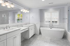 Bathroom with two sinks, bathtub, and sh